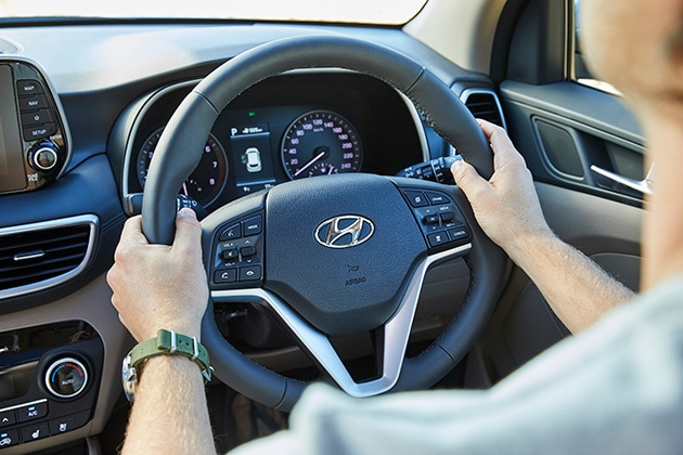 Man Holding Hyundai Steering Wheel