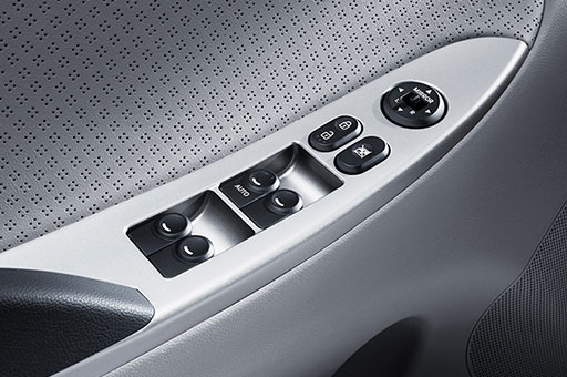 Power window adjustment controls on the armrest