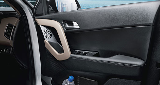 Front passenger side door storage with armrest