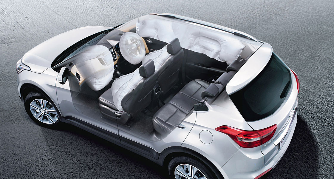 Side top view of white Creta with transparent doors and sunroof to show the interior