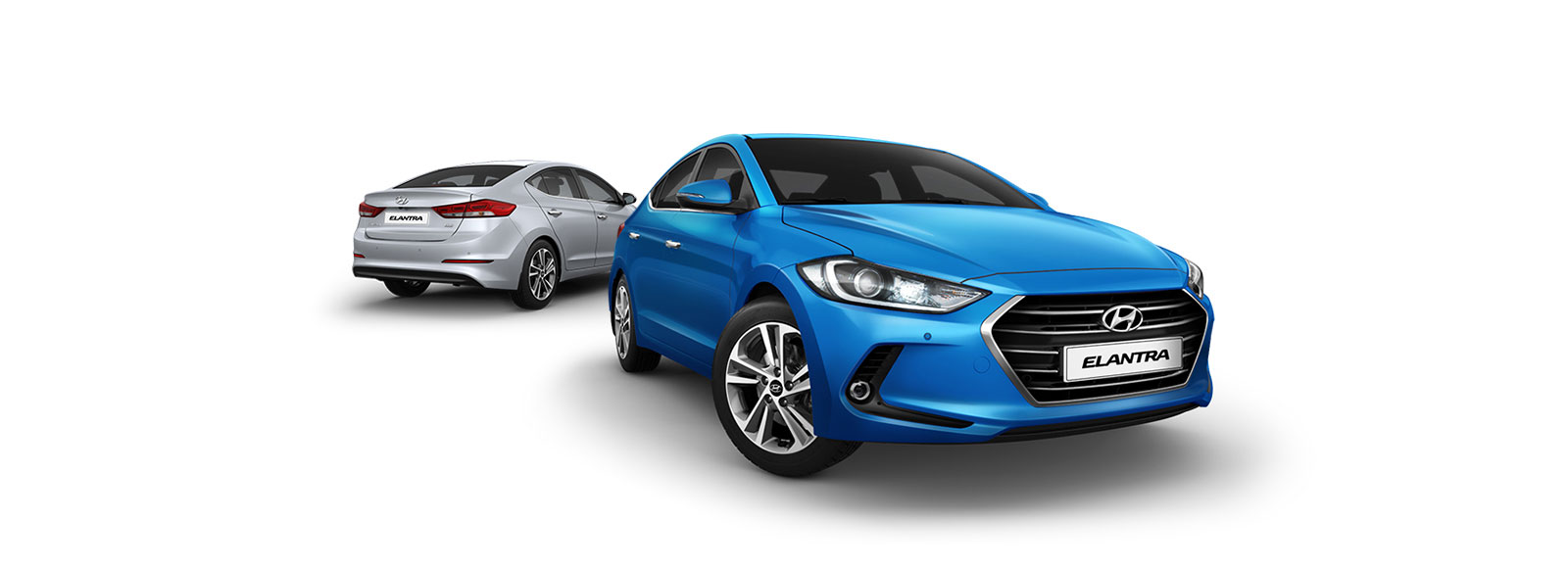 Side front view of blue Elantra in front and rear view of silver Elantra at the back