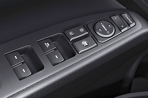 Power window control buttons on the armrest area