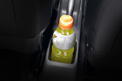 Drink bottle stored in the rear seat cup holder