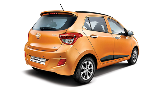 Right side rear view of orange Grandi10