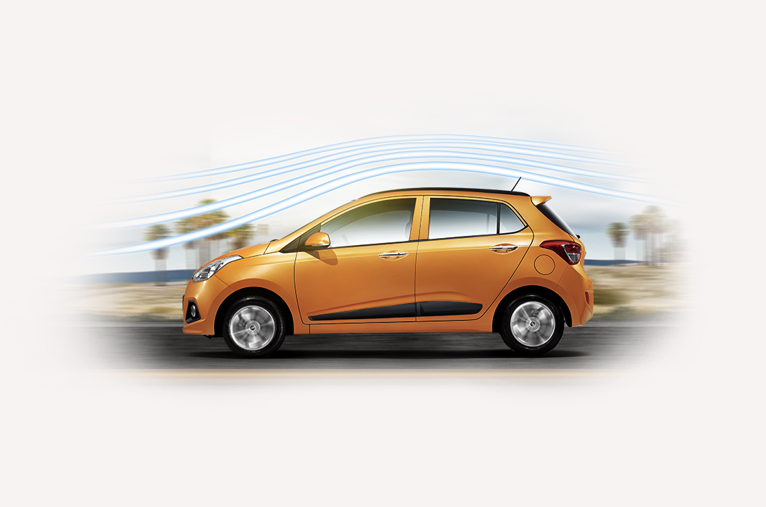Aerodynamic graphic around the exterior of tangerine orange Grand i10