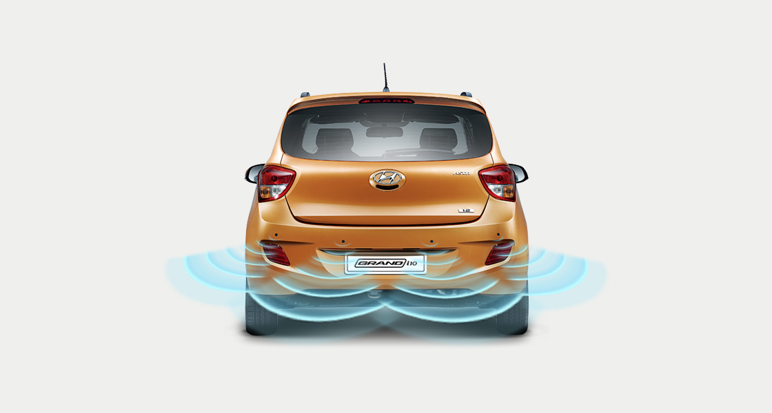 Rear parking assist system sensor illustration on tangerine orange Grand i10