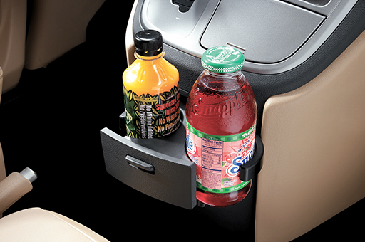 Closer view of H-1's cup holders with 2 beverage bottles