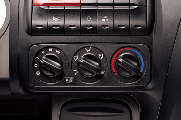 front image of air control system with several buttons and dials