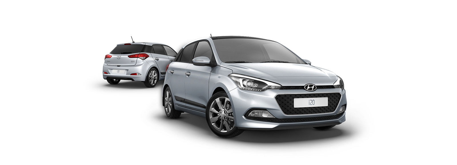 Side front view in front and side rear view of silver i20 at the back