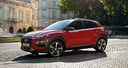 left side front view of red kona in the square