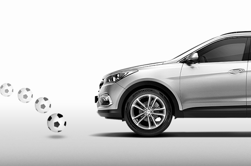 Brake assist system detects soccer ball in front of silver Santa Fe