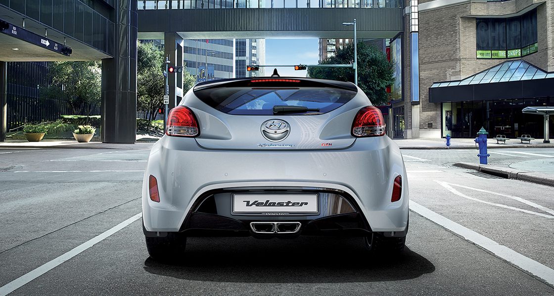 Rear view of white Veloster parked on the road in the city