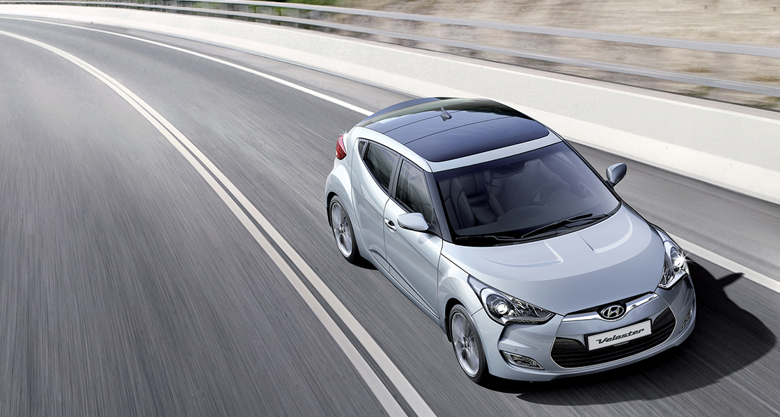 Sky view of silver Veloster driving on the road