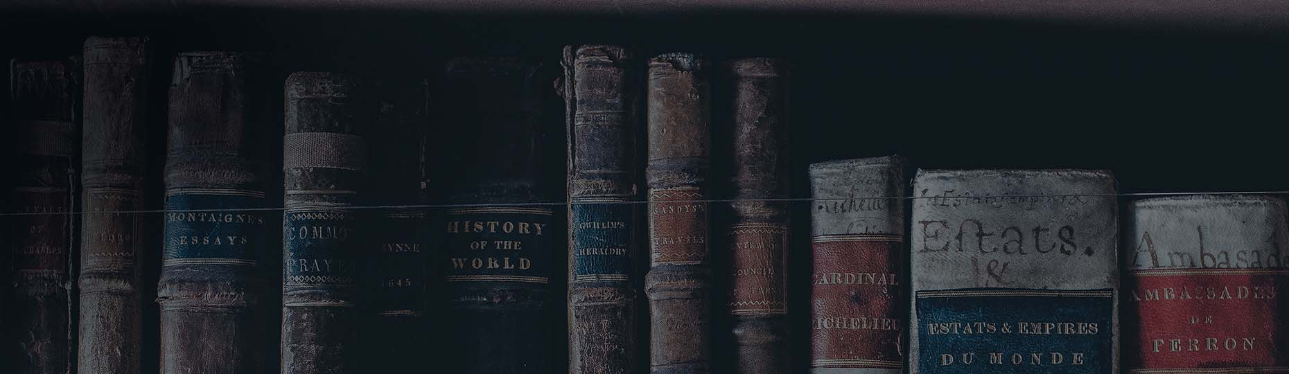 Old books are standing side by side