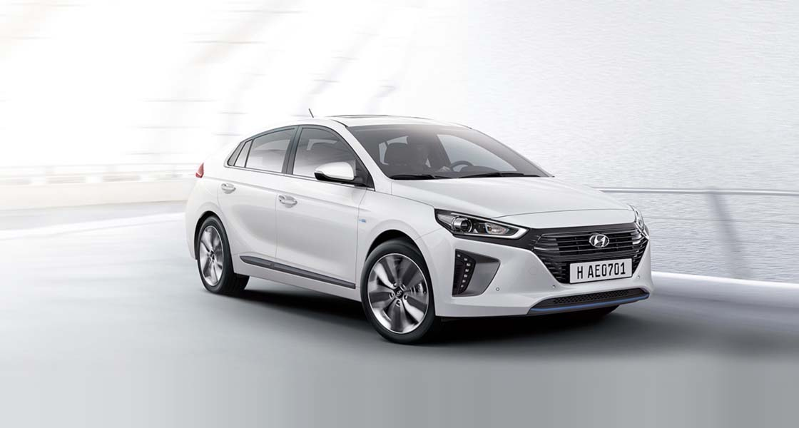 White Ioniq hybrid is driving.