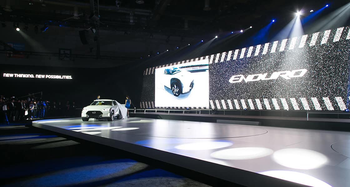 Panoramic view of unveiled 2015 Enduro car exhibited on a stage