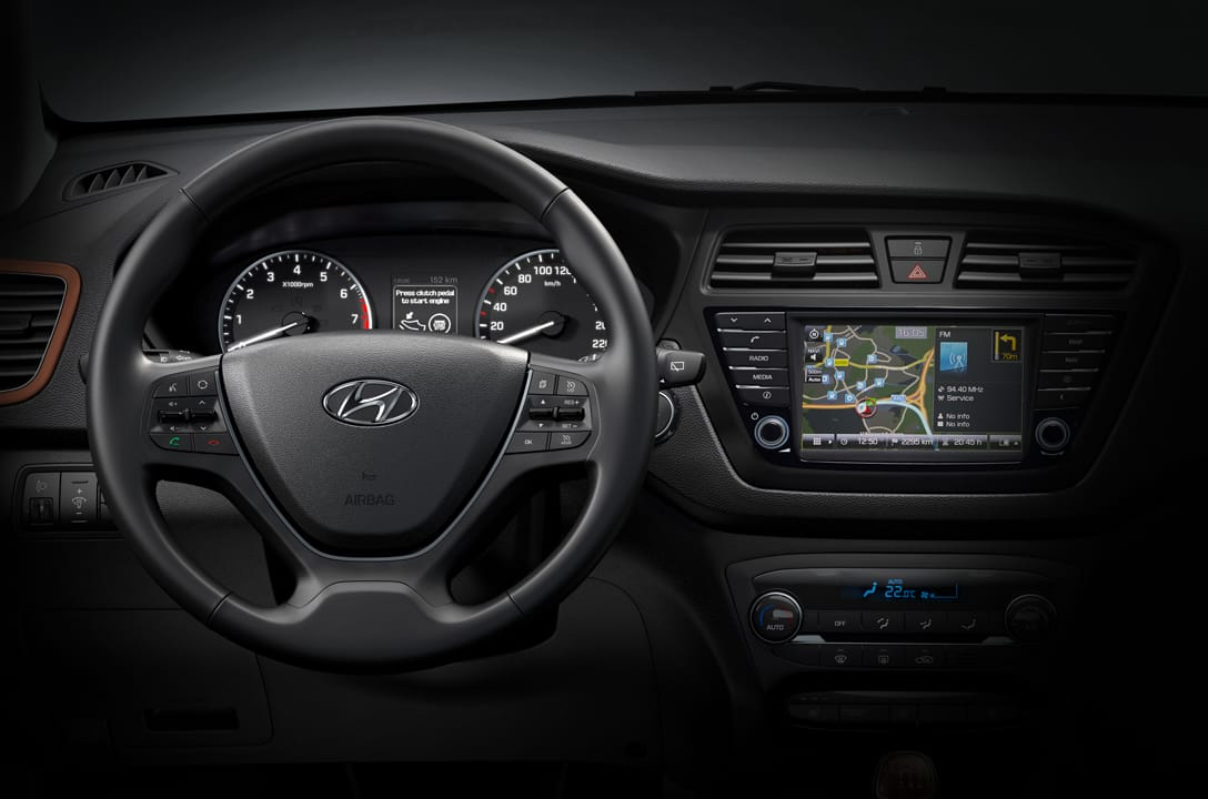 Interior view of Hyundai car closing up at its cockpit area with the operating system, cluster, and steering wheel