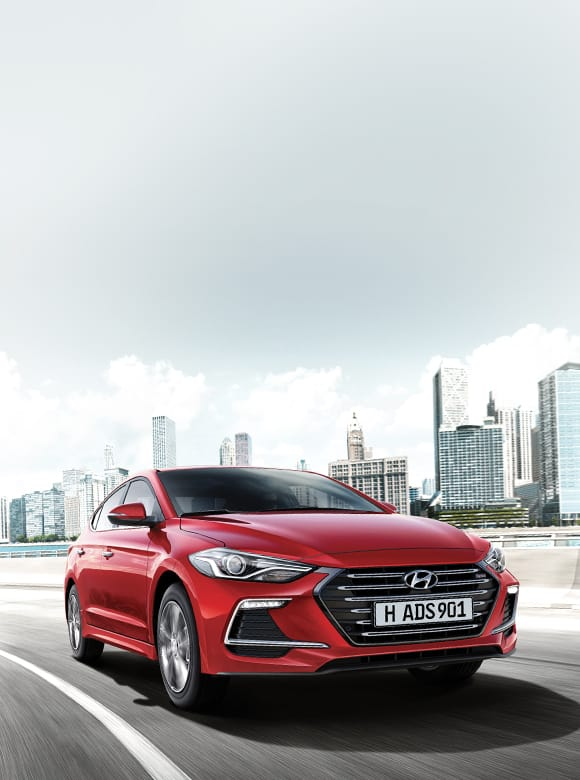 Red color Elantra Sport is driving on the urban road