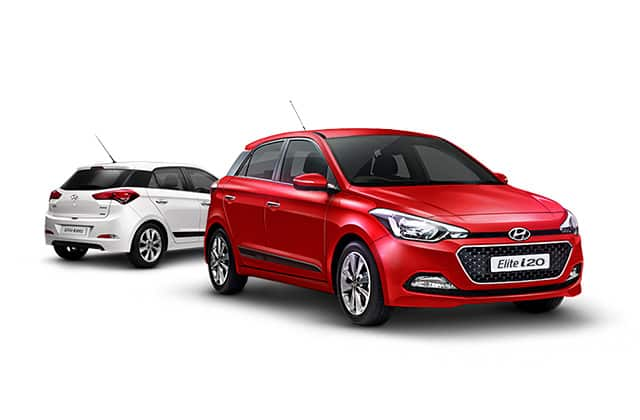 Side front view of red Elite i20 in front and white Elite i20 at the back