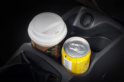 Drink can and cup stored in the floor console storage