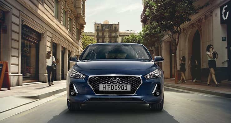 Front side view of blue i30 on the raod