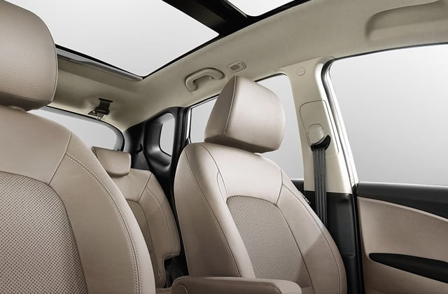 Low view of beige interior with sunroof