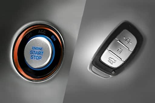 Engine start and stop button on the left and smart key on the right