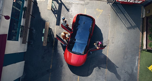 Top view of red veloster with open the door