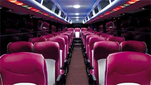 image of universe bus front to back interior with lights on