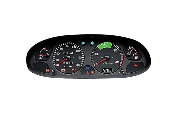 image of cluster including speedometer, RPM, gauges and warning lights
