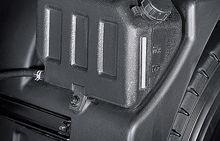 black radiator reservoir box mounted to the inside of fender