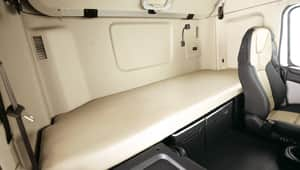 sleeper cabin bed behind of driver seat