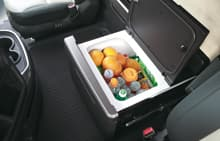 refrigerator's lid is opened including some fruits and bottles