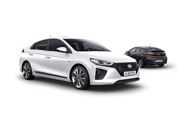 Side view of white Ioniq Hybrid in front and black Ioniq Hybrid parked behind