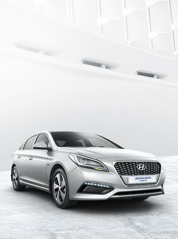 Silver color Sonata Hybrid is placed inside of a building with unique design