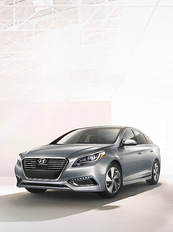 Gray color Sonata Hybrid is placed in front of bright geometrical background