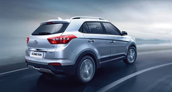Right side rear view of driving silver creta on the road
