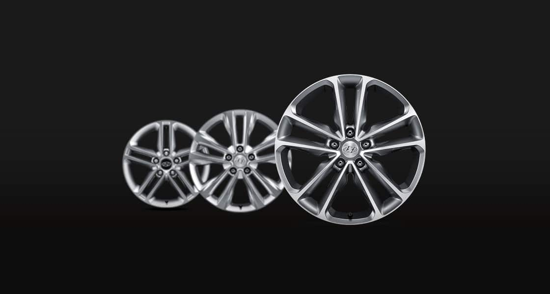 Three alloy wheels in different sizes