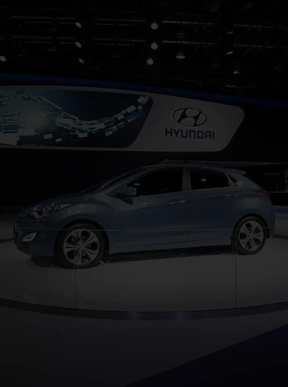 3 cars including a blue i30 are on the stage at 2011 Frankfurt International Motorshow