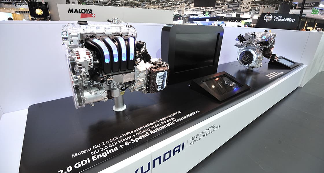 There are 2 of car components beside of a monitor each and one is called Nu 2.0 GDI Engine plus 6 Speed Automatic Transmission at 2011 Geneva International Motorshow