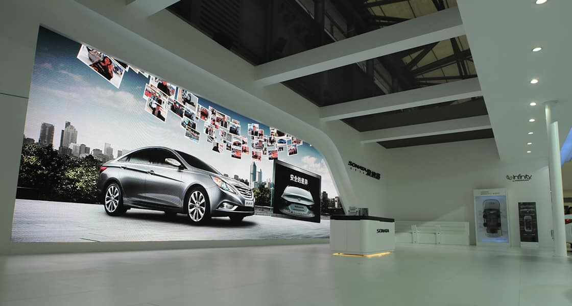 Side view of a huge screen showing a silver sedan and hundreds of photos of visitors at the hyundai motors venue at 2011 Shanghai International Motorshow