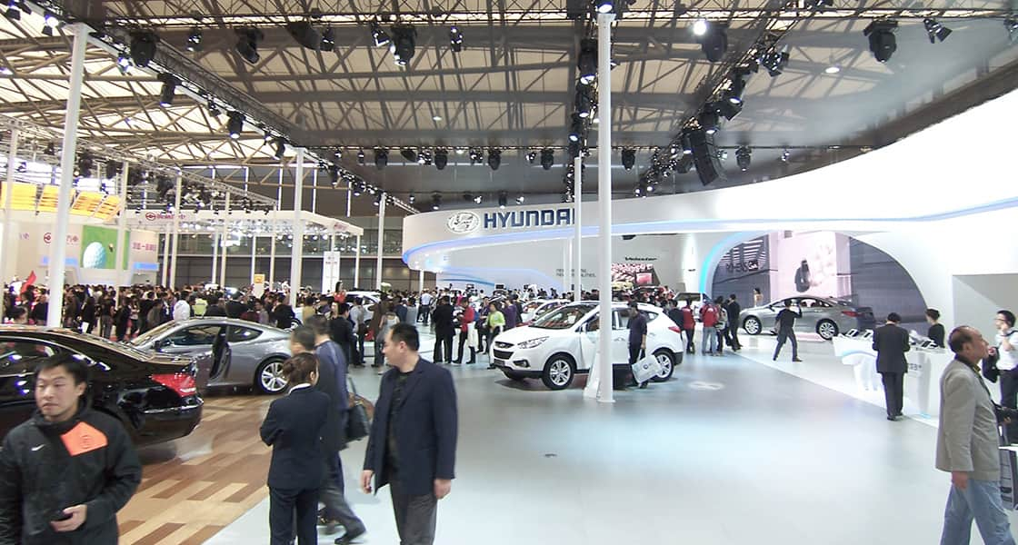 View of the center of hyundai motors and another venue full of visitors and cars at 2011 Shanghai International Motorshow
