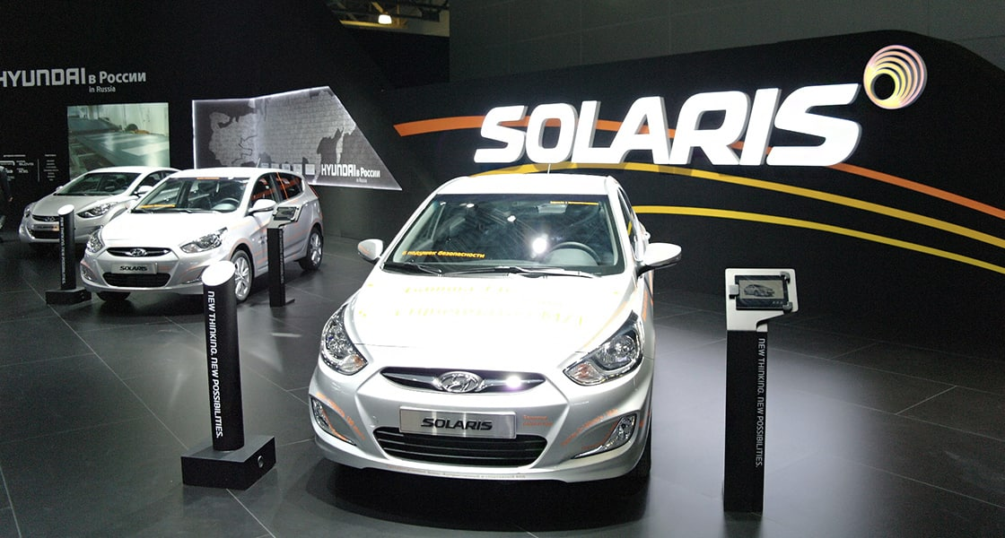 Front View of three white Solaris exhibited at the 2012 Moscow motorshow