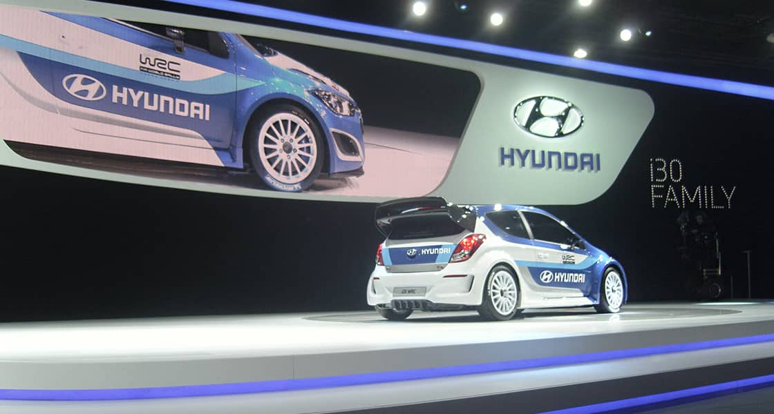 Right side-rear view of blue and white exhibited at the 2012 Paris motorshow
