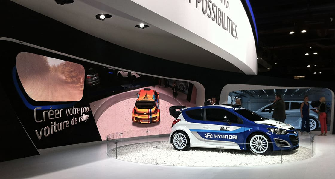 Right side view of blue and white I30 exhibited at the 2012 Paris motorshow