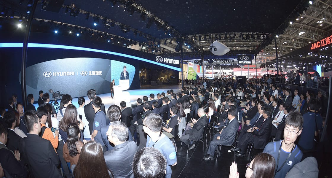 People standing infront of a speech stage