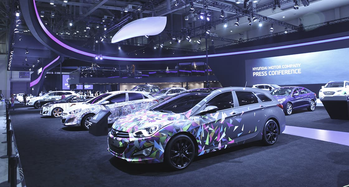 Left side-front view of various colorful car at the stage exhibited