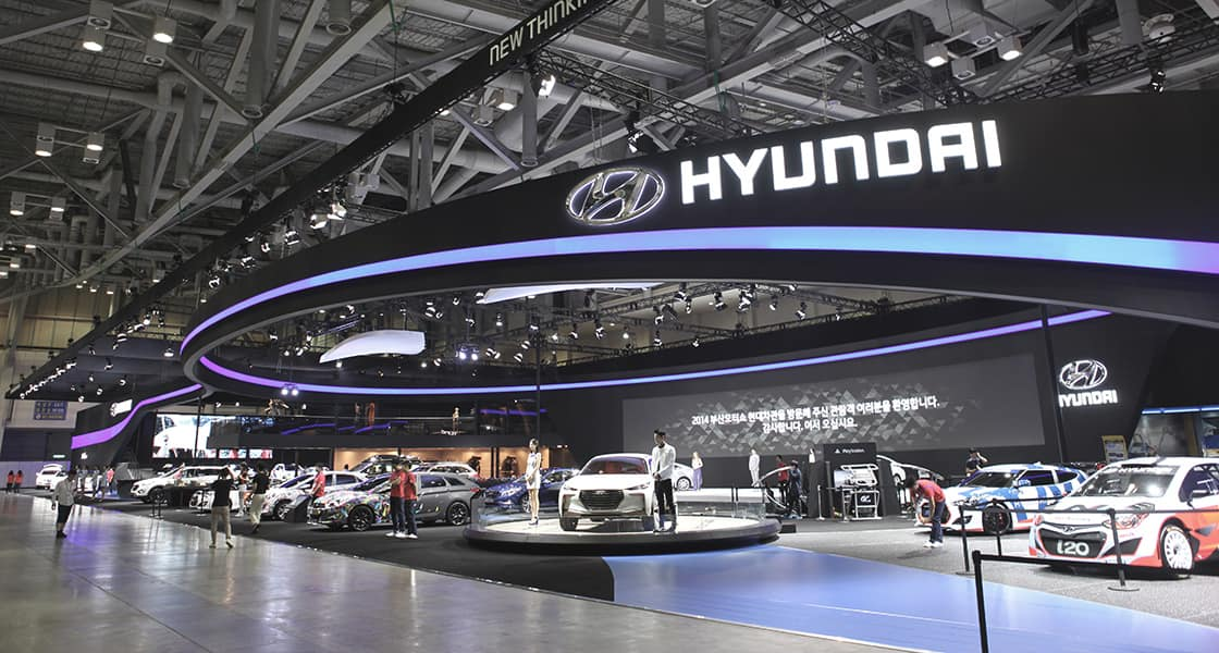 Panoramic view of motorshow with blue lined arch on the ceiling