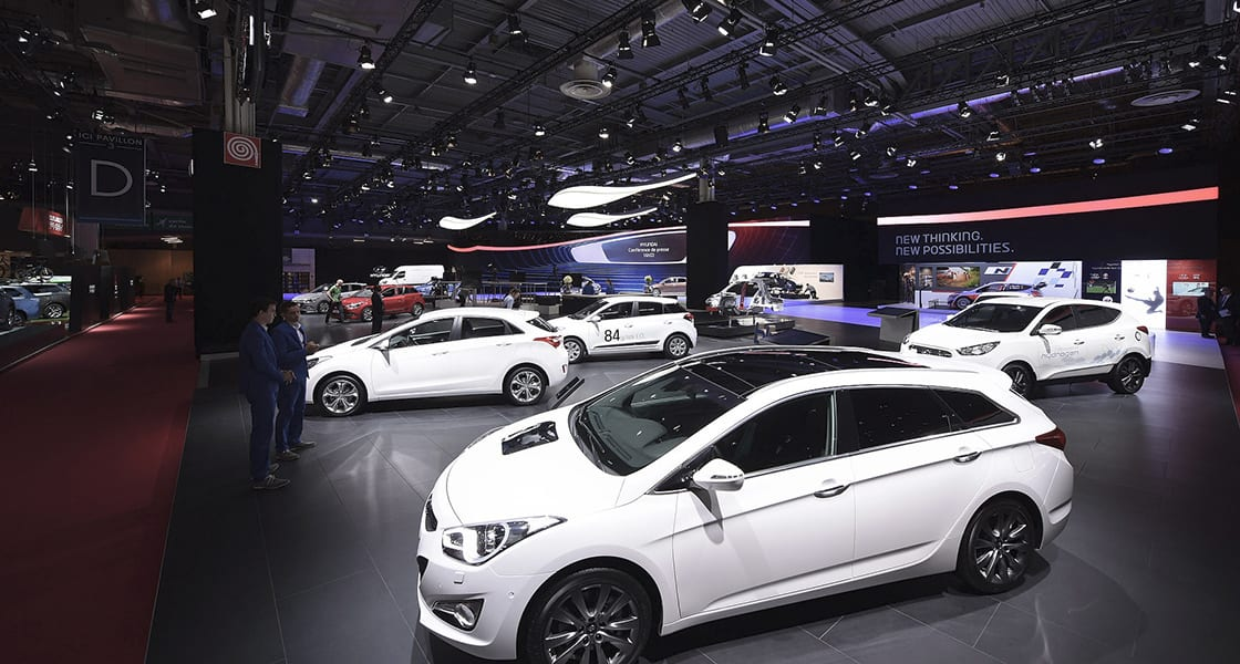 Left side view of many white cars exhibited at the 2014 Paris motorshow