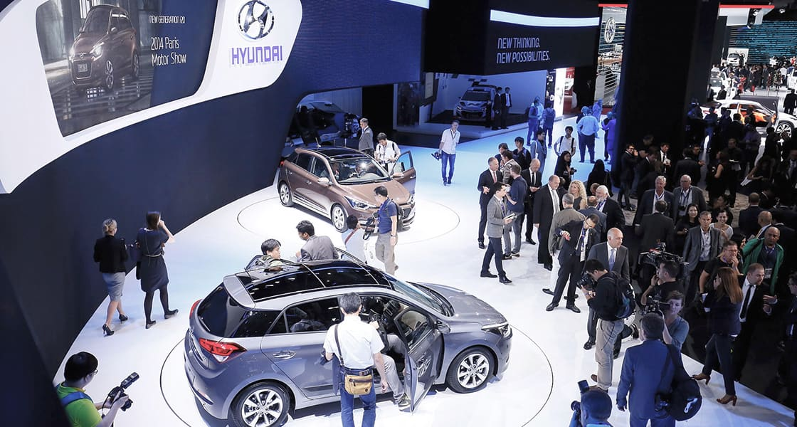 Top view of a crowd gathered exhibited at the 2014 Paris motorshow